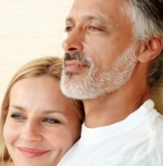 Portrait of mature couple spending quality time together in bed at home